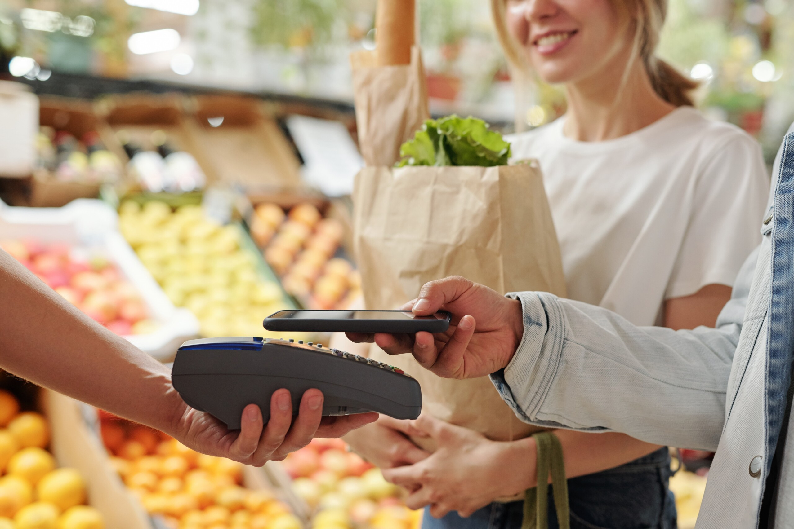 Contactless payment by a couple at a retail store